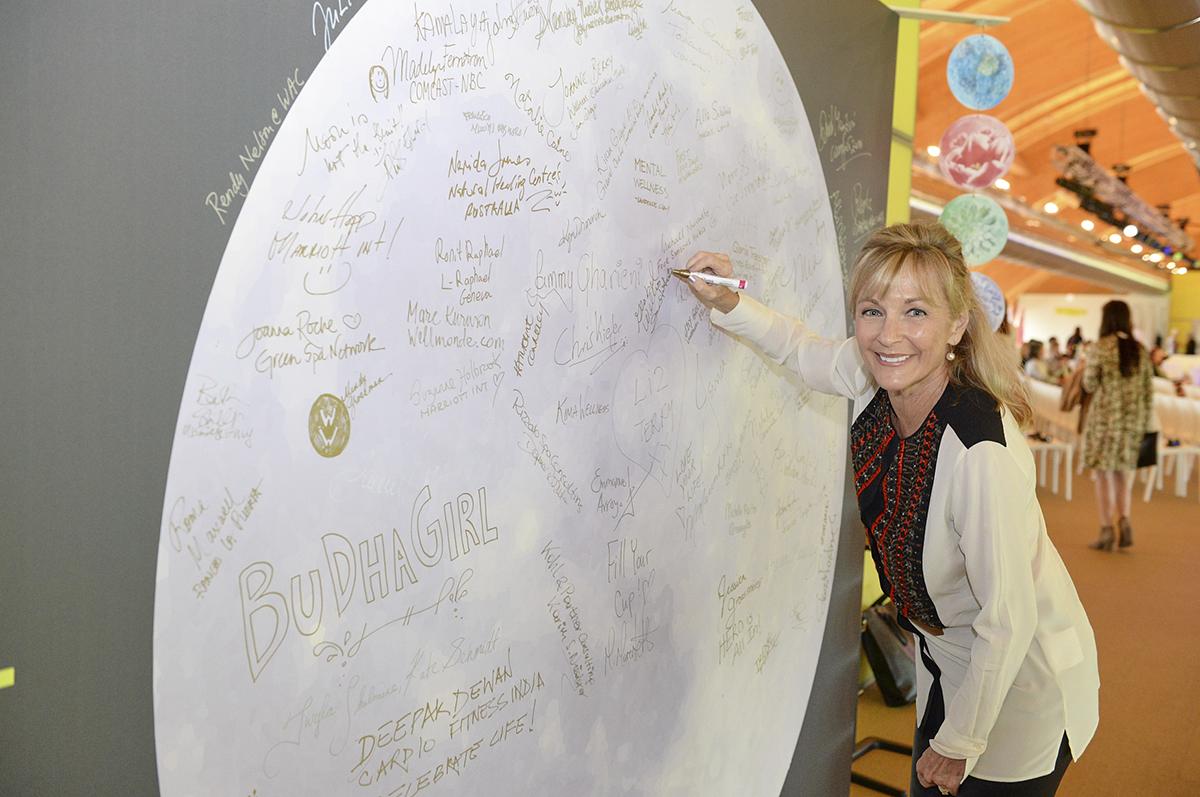 Wellness Moonshot<sup>TM</sup> Susie Ellis Signing Moon